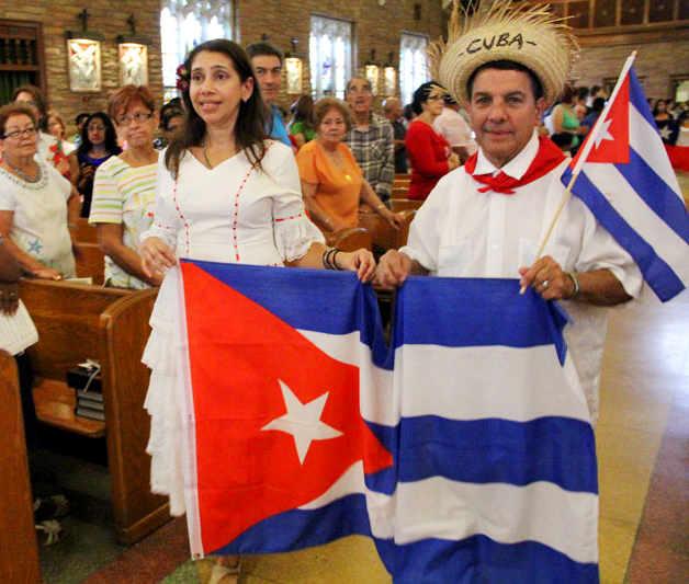 A young woman and man display their Cuban heritage at the Hispanic Heritage Mass Aug. 29 at holy Innocents Church, Philadelphia. (Sarah Webb)