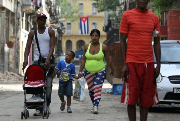 In this Dec. 26, 2014, file photo, a family walks down a street in Havana. (CNS photo/Alejandro Ernesto, EPA)