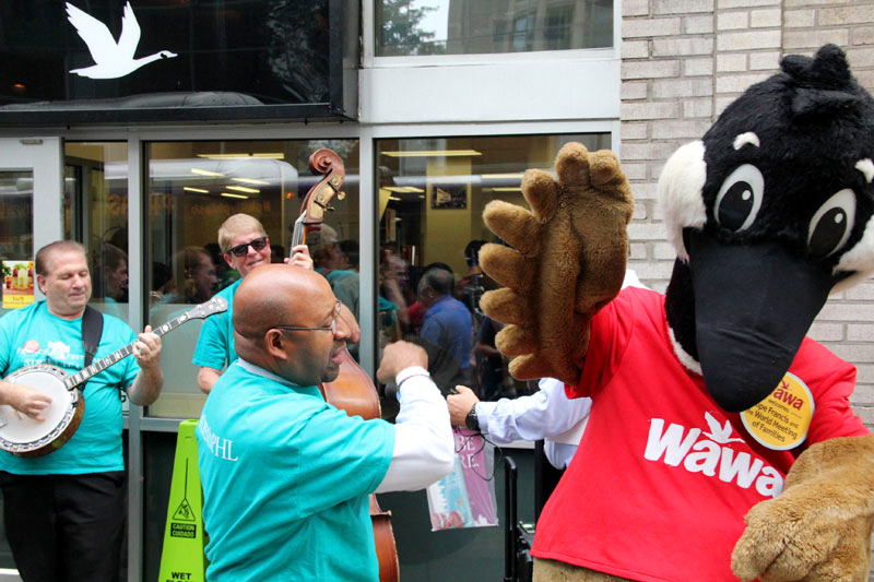 Wally Goose gets a high five from Mayor Michael Nutter