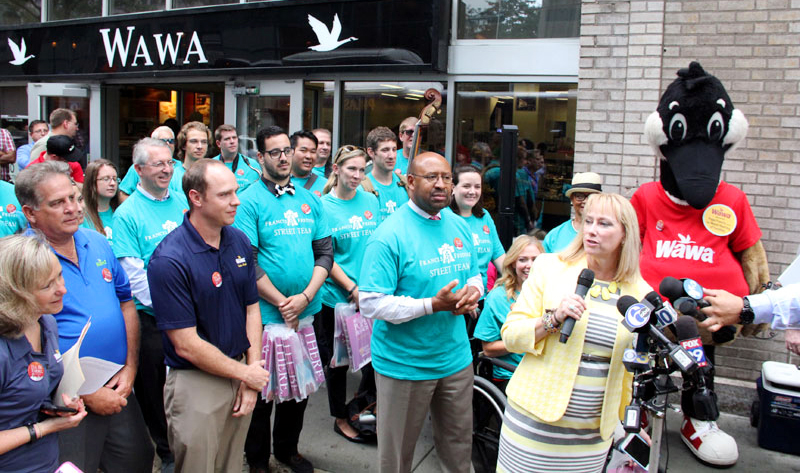 Donna Crilley Farrell, Executive Director of the World Meeting of Families - Philadelphia 2015 and Mayor Michael Nutter along with volunteers distribute #OpenInPHL kits to local businesses including WaWa.