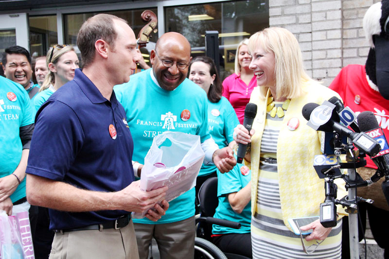 Dave Simonetti, Director of Store Operations for Wawa, Inc. receives his #OpenInPHL kit from Donna Crilley Farrell, Executive Director of the World Meeting of Families - Philadelphia 2015 as Mayor Michael Nutter looks on.