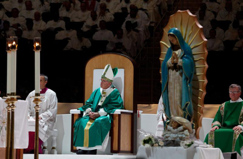 A statue of Mary is seen near the altar as Pope Francis celebrates Mass at Madison Square Garden in New York Sept. 25. (CNS photo/Paul Haring) See POPE-NY-MASS Sept. 25, 2015.
