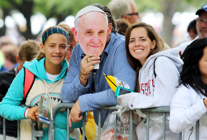 People found creative ways to get their picture with the pontiff. Photo by Bob Kelly.
