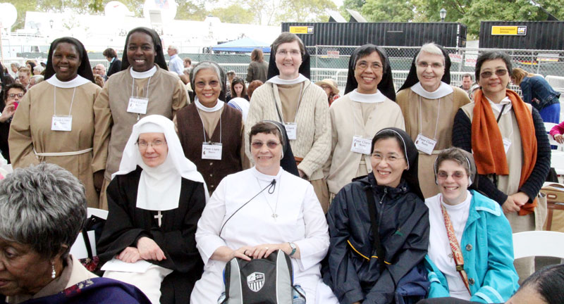 Good Shepard, Visitation, and Poor Clare nuns enjoy the time out of the monastery for such a momentous occasion. Photo by Sarah Webb