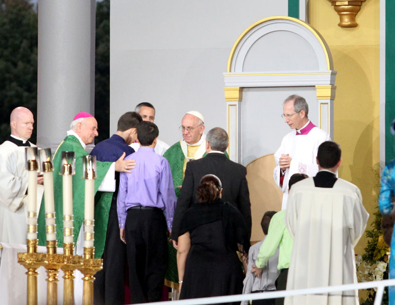 Pope Francis greets families at the end of mass. Photo by Sarah Webb