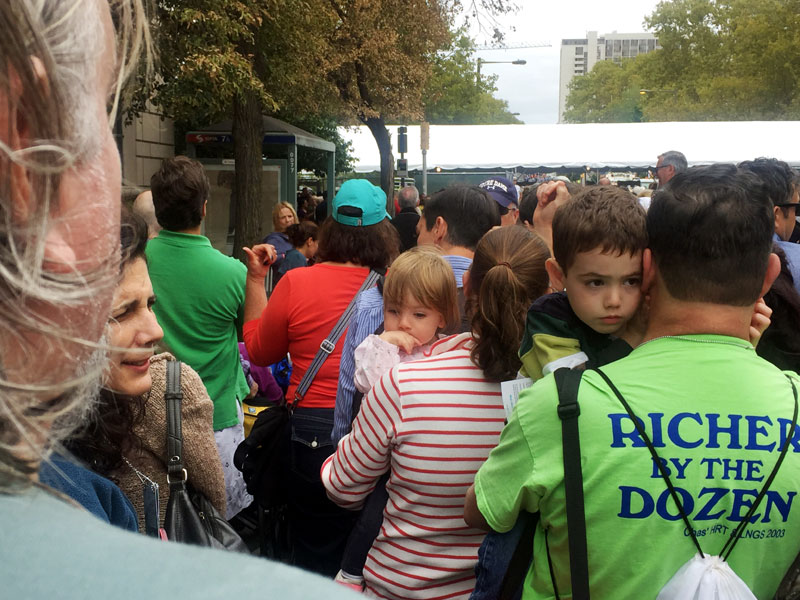 Children wait patiently with the parents in long lines for security check points. Photo by Sarah Webb