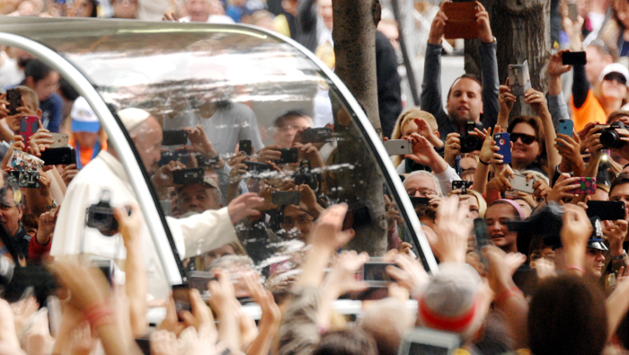 Pope Francis paraded down the Parkway to a sea of cell phones and cameras as the crowd took in the rare oppurtunity. Photo by D'Mont Reese.