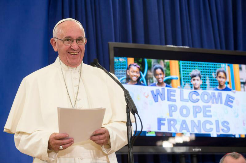 Pope Francis talks to immigrant families during his visits to Our Lady Queen of Angels School in the East Harlem area of New York Sept. 25. (CNS photo) See POPE-NY-IMMIGRANTS Sept. 25, 2015.