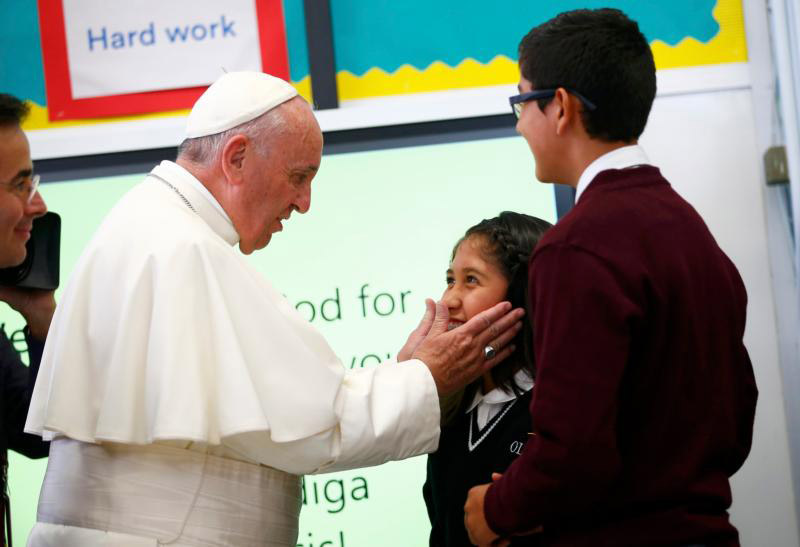 Pope Francis meets students at Our Lady Queen of Angels School in the East Harlem area of New York Sept. 25. (CNS photo/Tony Gentile, Reuters) See POPE-NY-IMMIGRANTS Sept. 25, 2015.