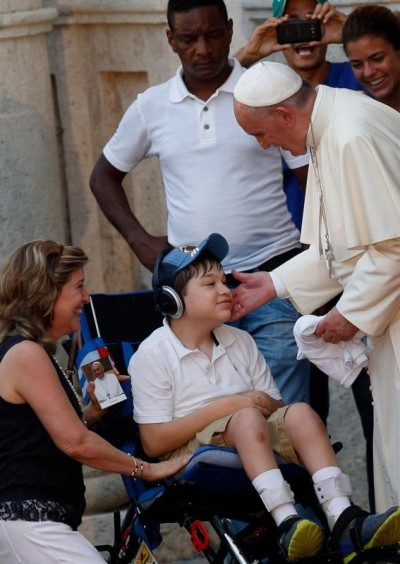 Pope Francis blesses a boy with a disability at the Father Felix Varela cultural center in Havana Sept. 20. (CNS photo/Paul Haring)