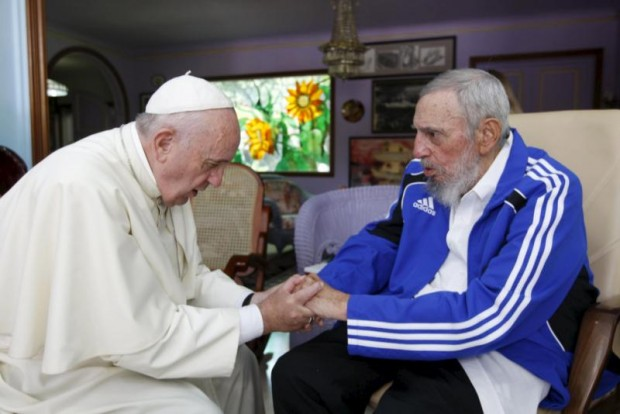 Pope Francis and former Cuban President Fidel Castro hold hands at Castro's residence in Havana Sept. 20. (CNS photo/Alex Castro, AIN handout via Reuters)
