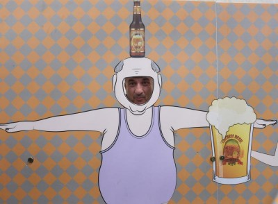 A Palestinian man poses in cutout at the Taybeh Oktoberfest in the West Bank village of Taybeh Sept. 19. (CNS photo/Debbie Hill)
