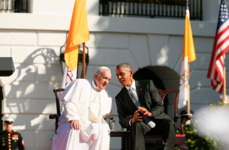 U.S. President Barack Obama leans in to talk to Pope Francis during a ceremony on the South Lawn of the White House in Washington Sept. 23. (CNS photo/Paul Haring)
