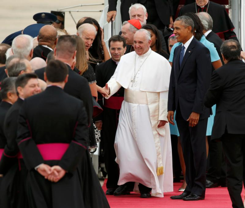 President Barack Obama walks with Pope Francis as the pope greets dignitaries upon his arrival at Joint Base Andrews in Maryland just outside of Washington Sept. 22. (CNS photo/Kevin Lamarque, Reuters)