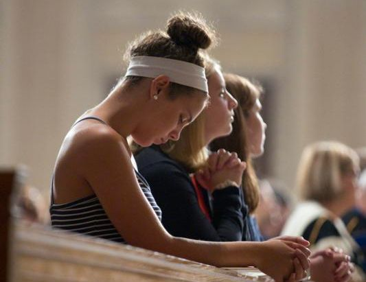 Students of The Catholic University of America and others pray during the school's annual Mass of the Holy Spirit, Sept. 3, at the Basilica of the National Shrine of the Immaculate Conception in Washington. (CNS photo/Jaclyn Lippelmann, Catholic Standard)
