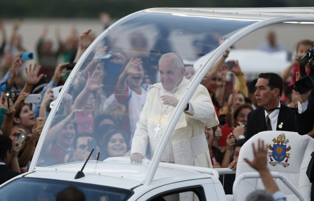 Pope Francis greets people in Asuncion, Paraguay, July 12, in a was is expected to be a similar way in Philadelphia Sept. 26-27. (CNS photo/Paul Haring)