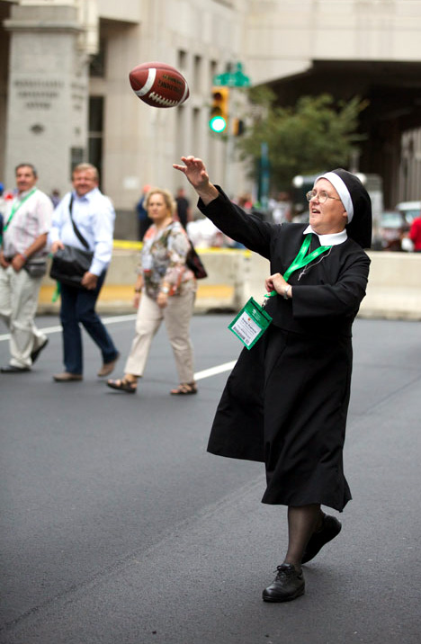 Sister Patricia Cushing, Sister of St Joseph the Worker, passes time throwing around a football. Photo by Bradley Digital.