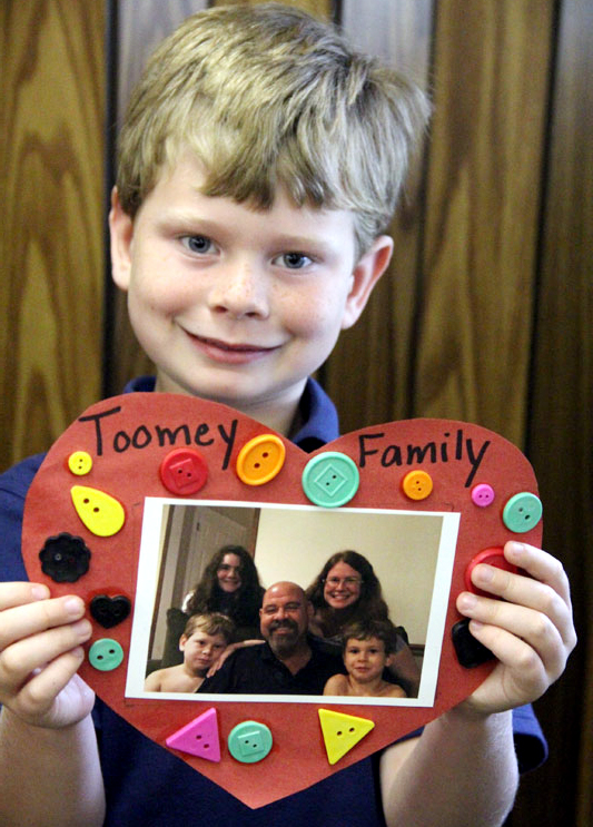 First grader Thomas Toomey proudly shows off his family heart.
