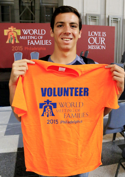 Robert Harrison from St Mary Parish in Boise, Idaho is excited to put on his volunteer shirt.