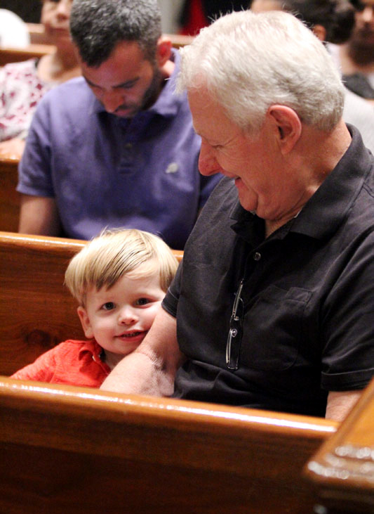 Dawson Coscia attends mass with his grandfather Jack Faller.