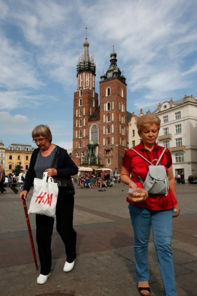 Women walk away from St. Mary's Basilica through the main square in Krakow, Poland, Sept. 3. Krakow will host the 2016 World Youth Day in July. (CNS photo/Nancy Wiechec)