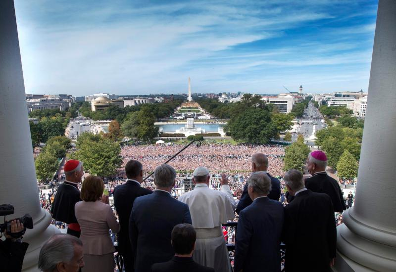 Pope Francis is welcomed to the Speakers Balcony at the U.S. Capitol by members of Congress Sept. 24. (CNS photo/Doug Mills, pool) See POPE-CONGRESS Sept. 24, 2015.
