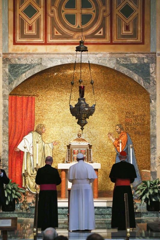 Pope Francis stands in the Blessed Sacrament Chapel for private prayer at the Cathedral of St. Matthew the Apostle, where he met with U.S. bishops in Washington Sept. 23. (CNS photo/Mark Wilson, pool) See POPE-US-BISHOPS Sept. 23, 2015.