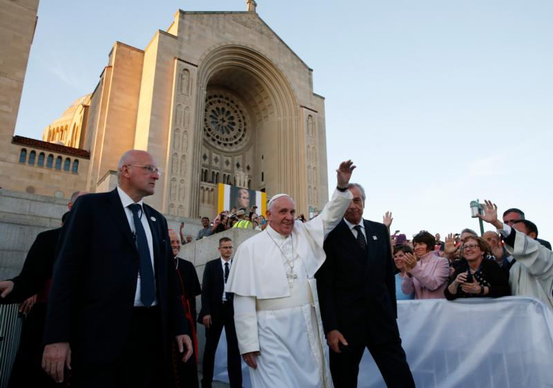 Pope Francis waves as he leaves the Basilica of the National Shrine of the Immaculate Conception after celebrating Mass and the canonization of Junipero Serra Sept. 23 in Washington. (CNS photo/Paul Haring) See POPE-SERRA-MASS Sept. 23, 2015.