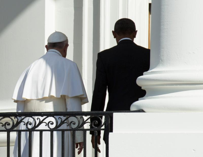 U.S. President Barack Obama and Pope Francis walk together at the end of an arrival ceremony on the South Lawn of the White House in Washington Sept. 23. (CNS photo/Joshua Roberts) See POPE-WHITE-HOUSE Sept. 23, 2015.