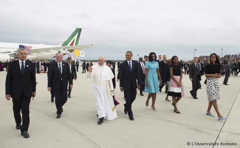 President Obama and first lady Michelle Obama walk with Pope Francis upon his arrival at Joint Base Andrews outside Washington, Sept. 22. (CNS photo/L'Osservatore Romano handout)
