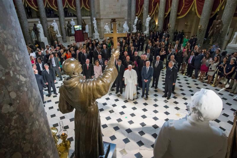 Pope Francis pauses in front of the  sculpture of St. Junipero Serra in Statuary Hall at the U.S. Capitol in Washington Sept. 24. (CNS photo/Michael Reynolds, pool) See POPE-CONGRESS Sept. 24, 2015.