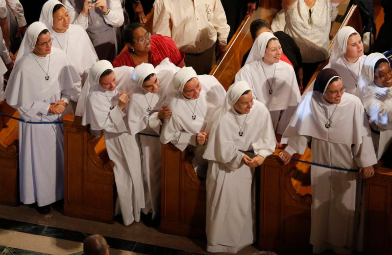Nuns leans out to see Pope Francis as he greets and blesses seminarians, novices and other guests inside the Basilica of the National Shrine of the Immaculate Conception in Washington Sept. 23. (CNS photo/Jim Bourg, Reuters)