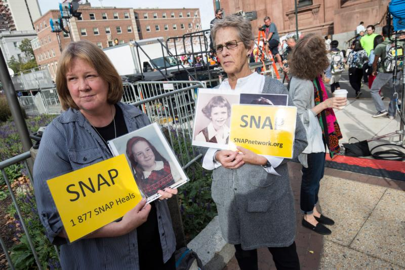 Becky Ianni of Burke, Va., and Barbara Dorris of St. Louis, both members of Survivors Network of those Abused by Priests demonstrate in front of the Cathedral Basilica of SS. Peter and Paul in Philadelphia Sept. 25. The pope met privately with a group of survivors of sexual abuse in Philadelphia Sept. 27. (CNS photo/Joshua Roberts)
