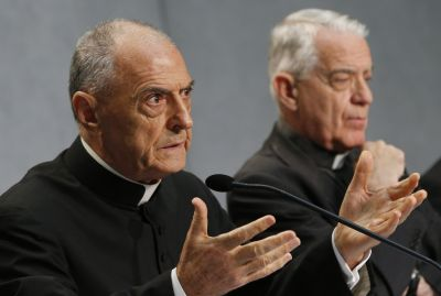 Msgr. Pio Vito Pinto, dean of the Roman Rota, a Vatican court, speaks at a press conference for the release of Pope Francis' documents concerning changes to marriage annulments at the Vatican Sept. 8. Also pictured is Jesuit Father Federico Lombardi, the Vatican spokesman. (CNS photo/Paul Haring)