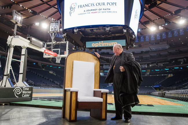 Cardinal Timothy M. Dolan of New York speaks Sept. 2 about a chair Pope Francis will use when he celebrates Mass in Madison Square Garden. The Mass is set for Sept. 25. (CNS photo/Lucas Jackson, Reuters)