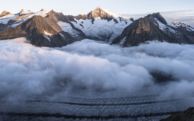 "The Aletsch glacier is seen in late July in Fiesch, Switzerland. While there is not unanimous agreement about the causes of climate change, global warming and extreme weather, Pope Francis repeated his conviction that ""a widespread consensus is emerging"" that places much of the blame on irresponsible human action. (CNS photo/Dominic Steinmann, Reuters)"