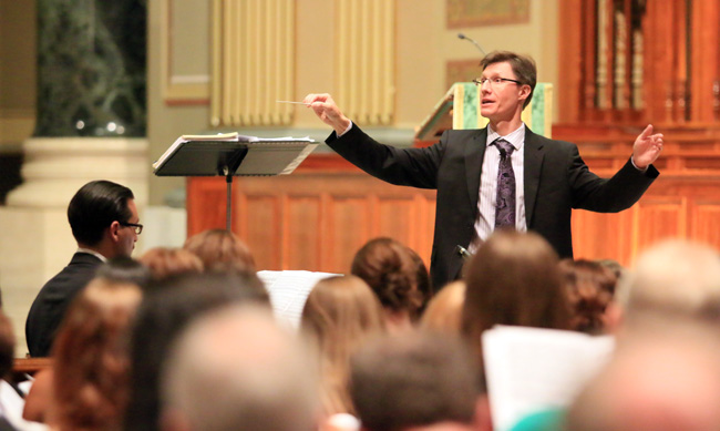 David Kimock conducts a rehearsal of the special choir, made up of parishioners from across the region, that will sing at the Cathedral Basilica of SS. Peter and Paul during the Mass celebrated by Pope Francis Saturday morning, Sept. 26. (Photo by Sarah Webb)