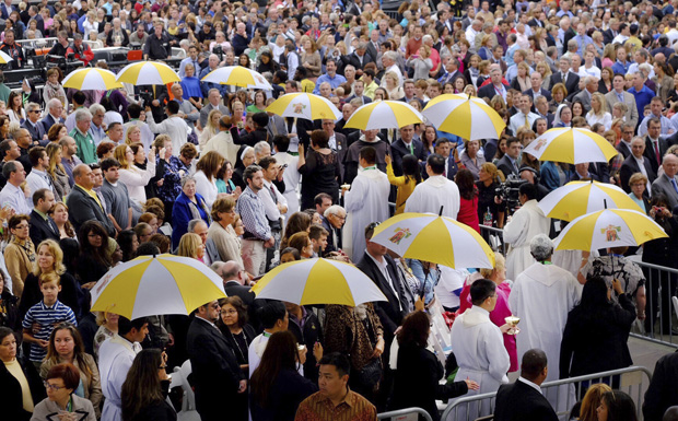 Priests move to distribute Communion at the closing Mass of the World Meeting of Families in Philadelphia Sept. 27. (CNS photo/Teak Phillips, St. Louis Review)