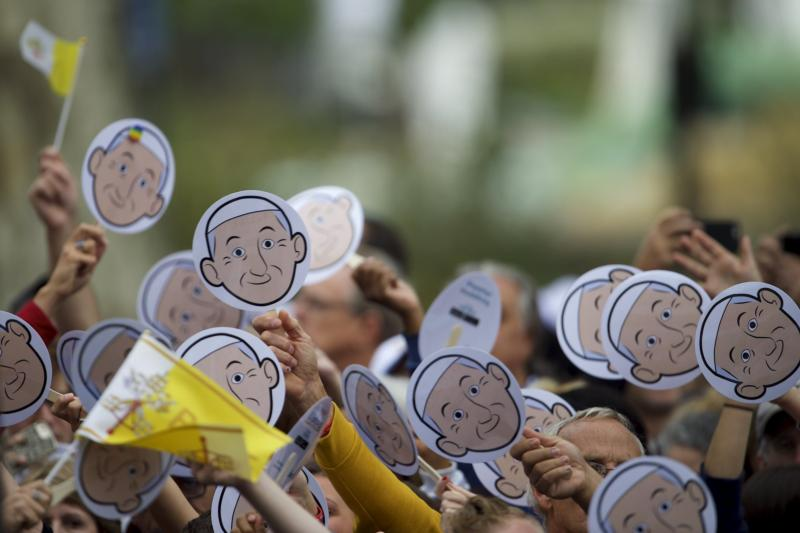 Pilgrims wave cardboard cutouts of Pope Francis as they gather outside the Cathedral Basilica of SS. Peter and Paul to see the pope in Philadelphia Sept. 26. (CNS photo/Mark Makela, Reuters)