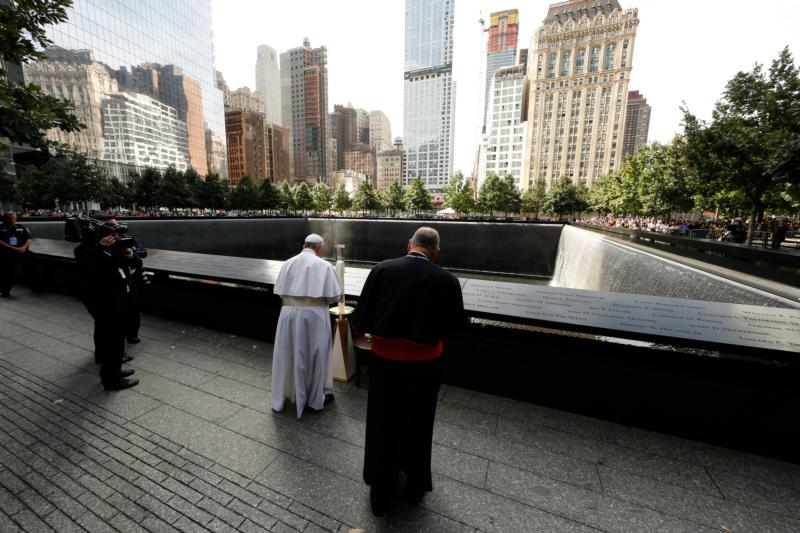 Pope Francis prays at the ground zero 9/11 Memorial in New York Sept. 25. (CNS photo/Paul Haring) See POPE-GROUND-ZERO Sept. 25, 2015.