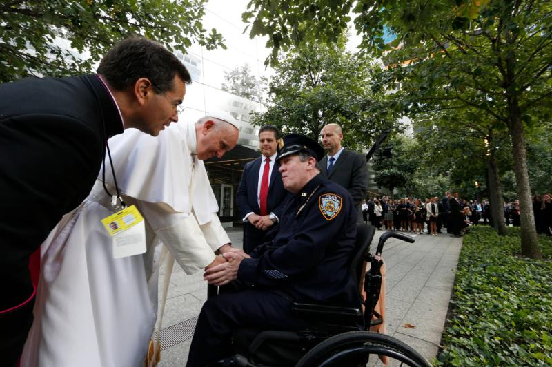 Pope Francis greets a New York City police officer as he visits the ground zero 9/11 Memorial in New York Sept. 25. (CNS photo/Paul Haring) See POPE-GROUND-ZERO Sept. 25, 2015.
