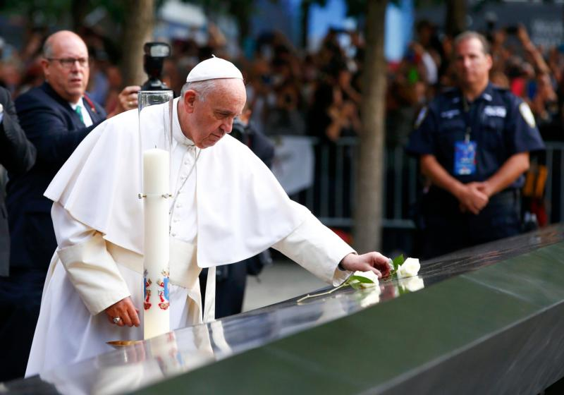 Pope Francis places a rose at the South Pool of the National 9/11 Memorial and Museum Sept. 25 in New York. (CNS photo/Tony Gentile) See POPE-GROUND-ZERO Sept. 25, 2015.