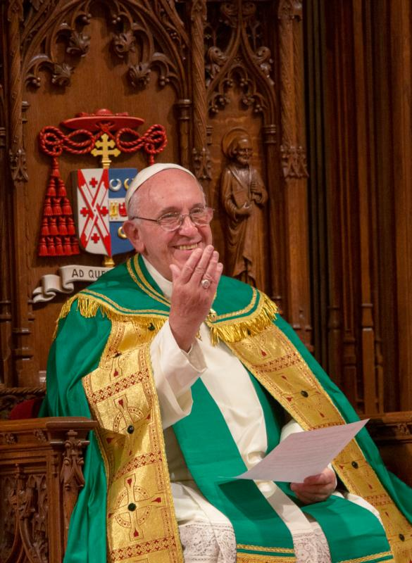 Pope Francis gestures as Cardinal Timothy M. Dolan speaks during an evening prayer service with in St. Patrick's Cathedral in New York Sept. 24. (CNS photo/Mike Crupi) See POPE-NY-VESPERS Sept. 24, 2015.