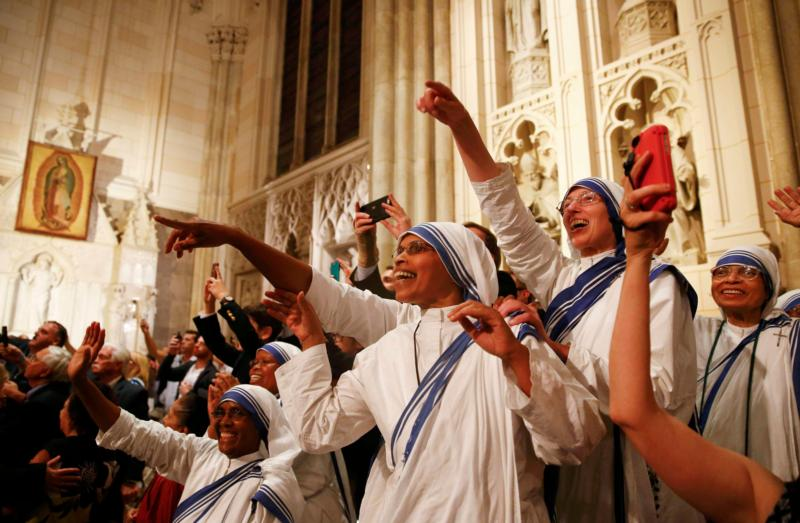 Members of the Missionaries of Charity cheer as Pope Francis arrives to St. Patrick's Cathedral for an evening prayer service Sept. 24. (CNS photo/Tony Gentile, Reuters) See POPE-NY-VESPERS Sept. 24, 2015