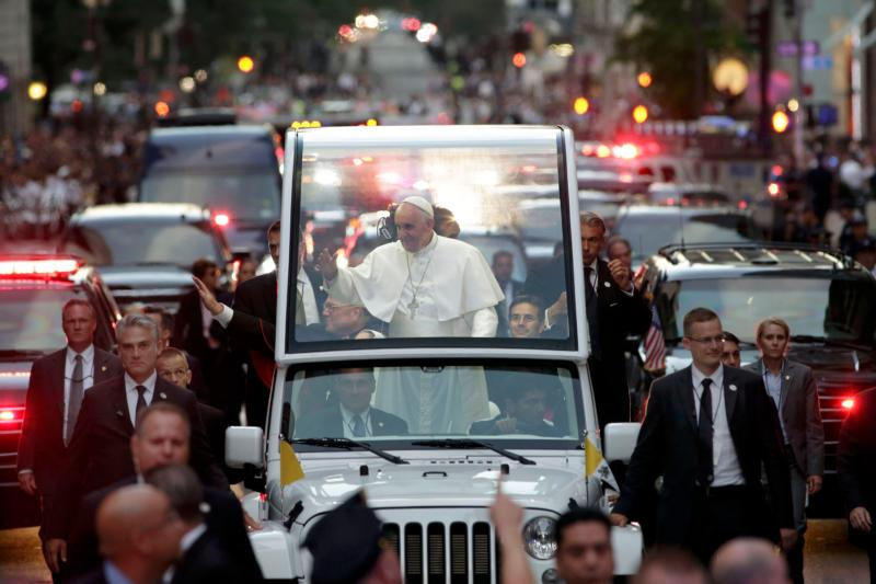 Pope Francis waves to the crowd as he rides down Fifth Avenue in New York Sept 24. (CNS photo/Richard Drew, pool) See POPE-NY-VESPERS Sept. 24, 2015