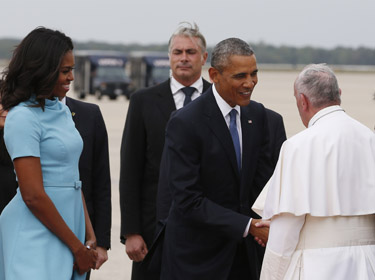 President Barack Obama and first lady Michelle Obama welcome Pope Francis to the United States on the airfield at Joint Base Andrews in Maryland Sept. 22. (CNS photo/Paul Haring)