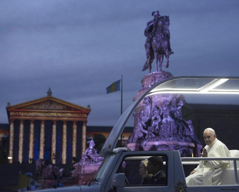 Pope Francis rides in the popemobile past Philadelphia monuments as he arrives to for the Festival of Families during the World Meeting of Families Sept. 26. (CNS photo/L'Osservatore Romano via Reuters) See POPE-FAMILIES-FESTIVAL Sept. 26, 2015.