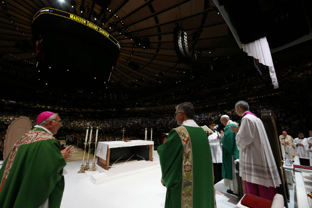 Pope Francis celebrates Mass with a full house at Madison Square Garden in New York Sept. 25. (CNS photo/Paul Haring)