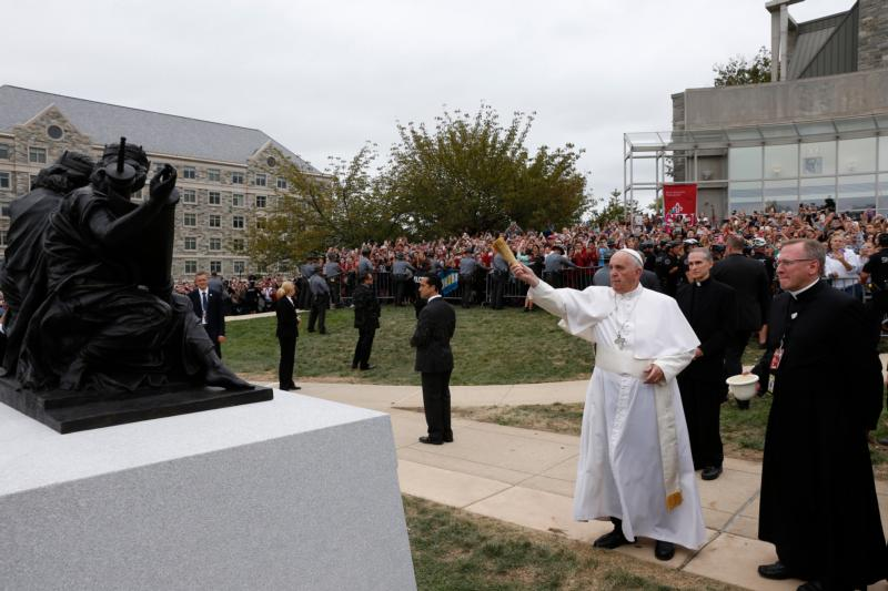 """Pope Francis blesses a sculpture during a brief stop at St. Joseph's University in Philadelphia Sept. 27. The sculpture commemorates the 50th anniversary of """"Nostra Aetate,"""" the Second Vatican Council Declaration on the Relationship of the Church to Non-Christian Religions.  (CNS photo/Paul Haring) See POPE-PHILLY-UNIVERSITY Sept. 27, 2015."""