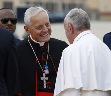 Washington Cardinal Donald W. Wuerl greets Pope Francis upon his arrival at Joint Base Andrews airfield outside Washington Sept. 22. (CNS photo/Paul Haring)
